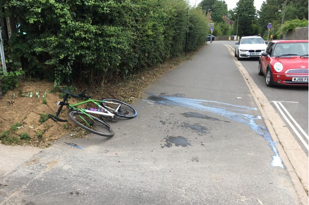 Bike lying on ground next to explosion of sealant from tubeless tyre