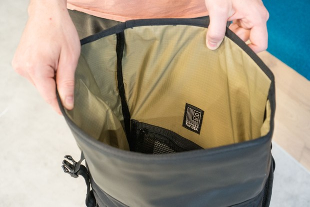 Open roll-top on rucksack
