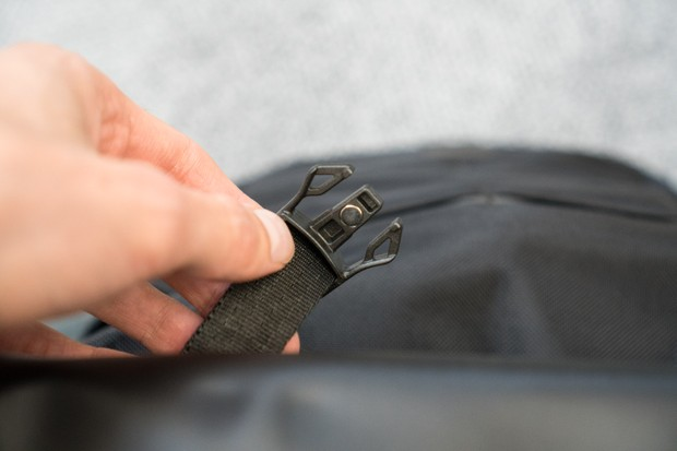 Magnetic clip on rucksack