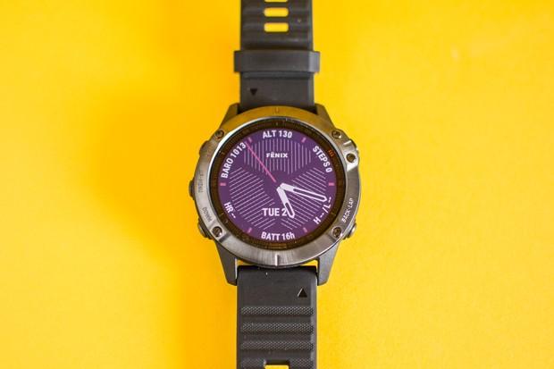Garmin smartwatch on yellow background