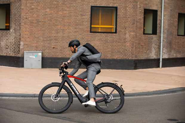 Trek Allant+9.9S being ridden by a man in a suit on the street