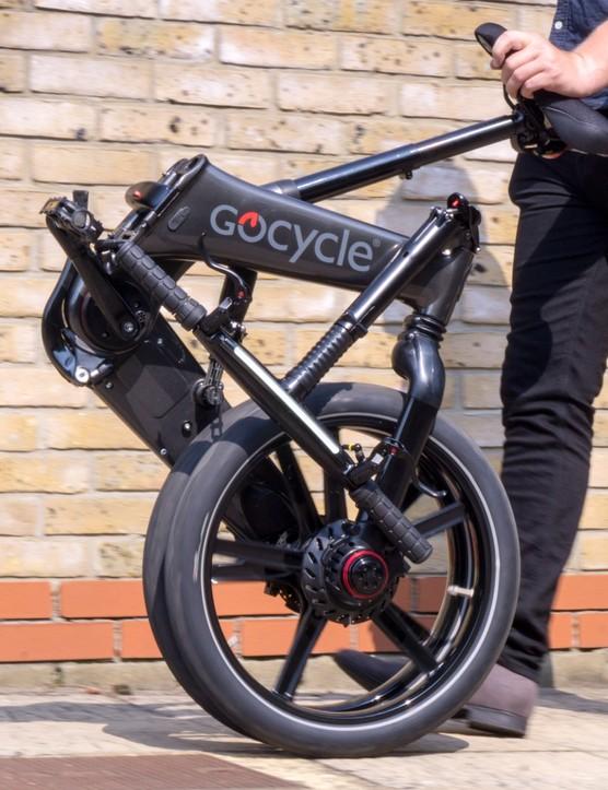 Gocycle GXi folded wheeling along