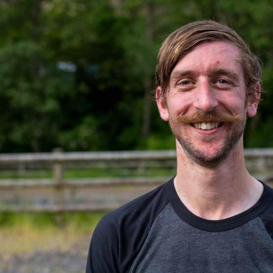 Will Soffe, a moustachioed mountain biker
