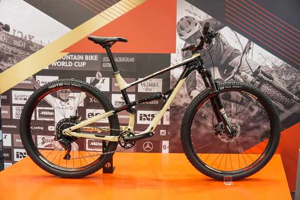 cream and black full suspension mountain bike
