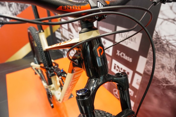 cream and black full suspension mountain bike