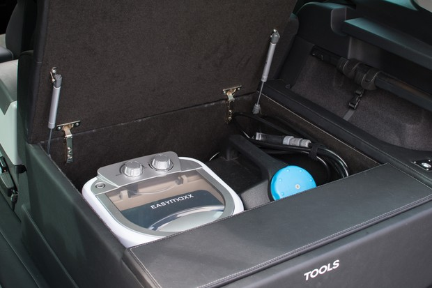 Portable washing machine and bike washer in storage compartment of car