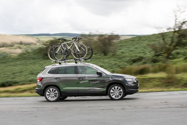 Skoda crossover with bikes on roof driving