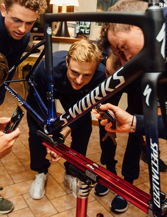 group of cyclists study the Specialized limited edition version of its S-Works Tarmac Disc frameset