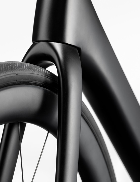 Fork and front wheel area of e-road bike showing large tyre clearance.