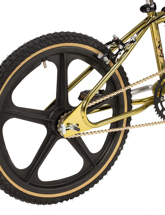 Five spoke wheel on gold BMC bike.
