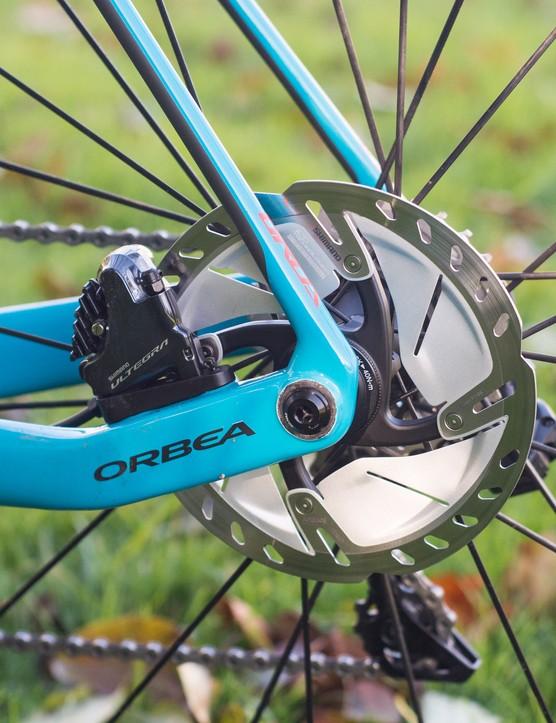 Rear Shimano disc brake on road bike.