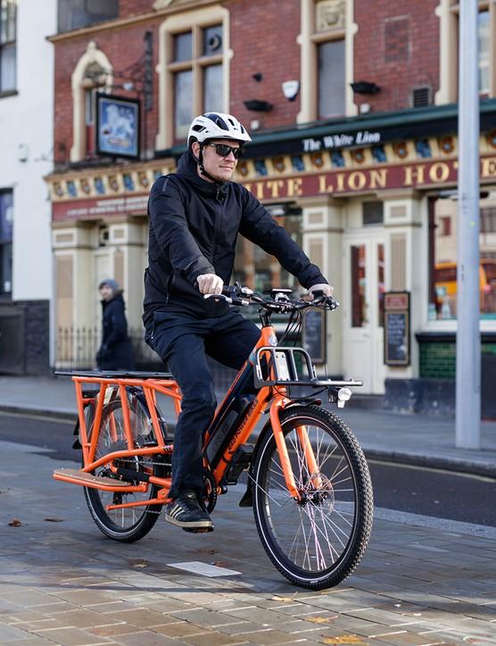 Male cyclist riding the Rad Power RadWagon electric cargo bike