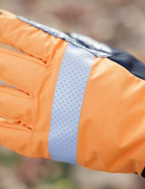 Orange back of glove with reflective strip
