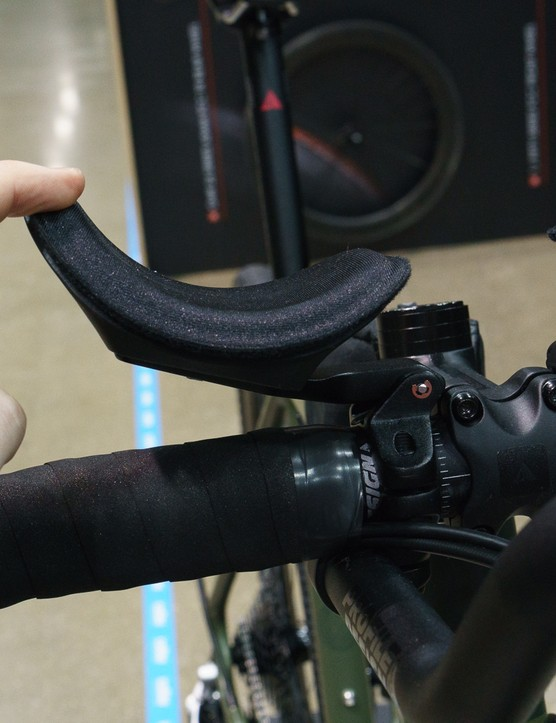 Finger pushing down sprung arm rest