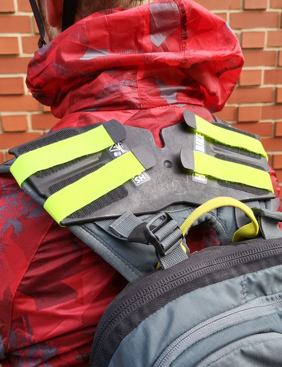 Plate strapped to rucksack straps