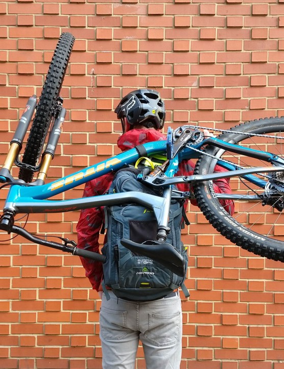 Bike hanging from rucksack