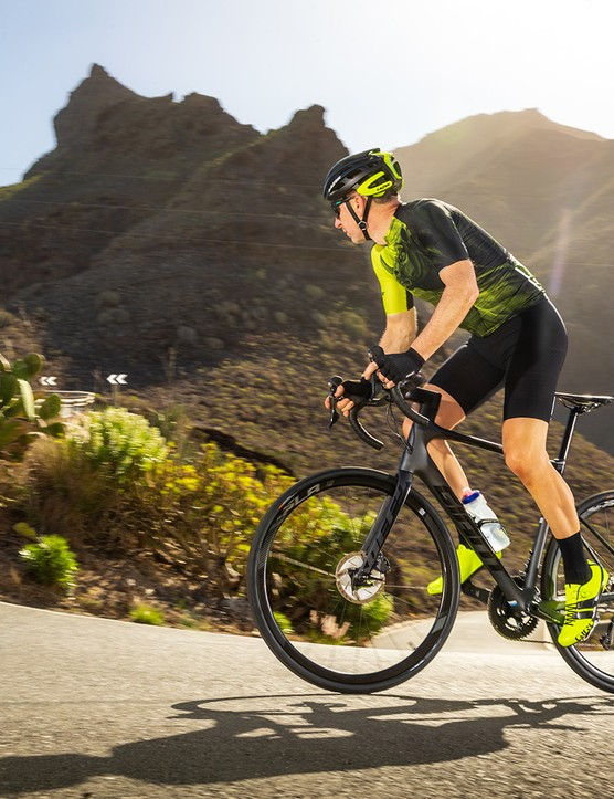 Male cyclist riding Giant Defy Advanced Pro 2 through Spanish mountains
