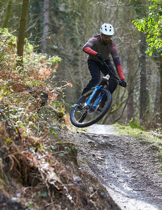 Male cyclist riding full suspension mountain bike