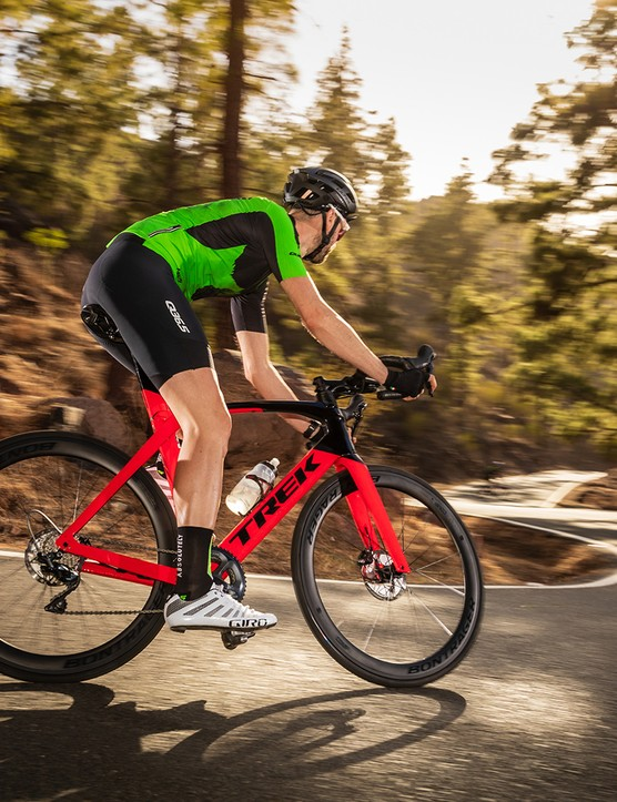 Cyclist in green top riding the Trek Madone SL6 Disc