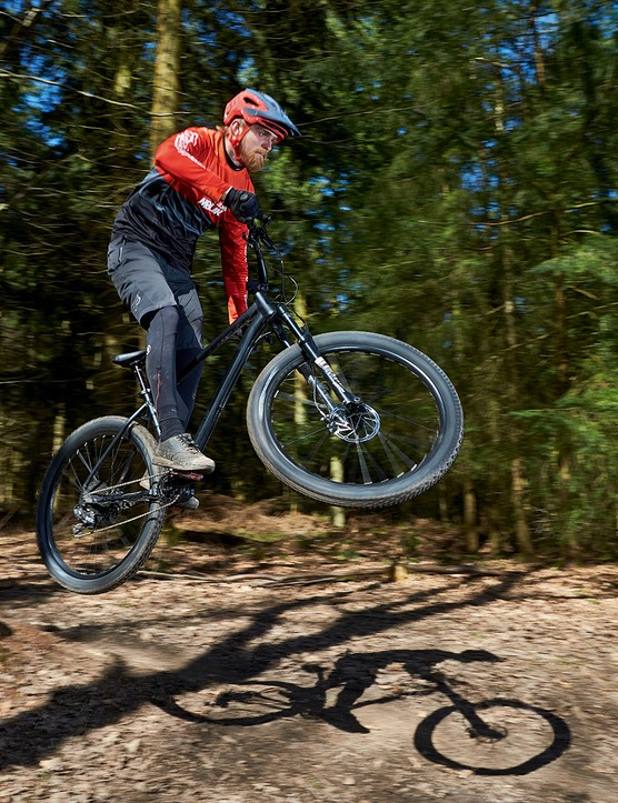 Male cyclist riding a Calibre Line 29 hardtail mountain bike