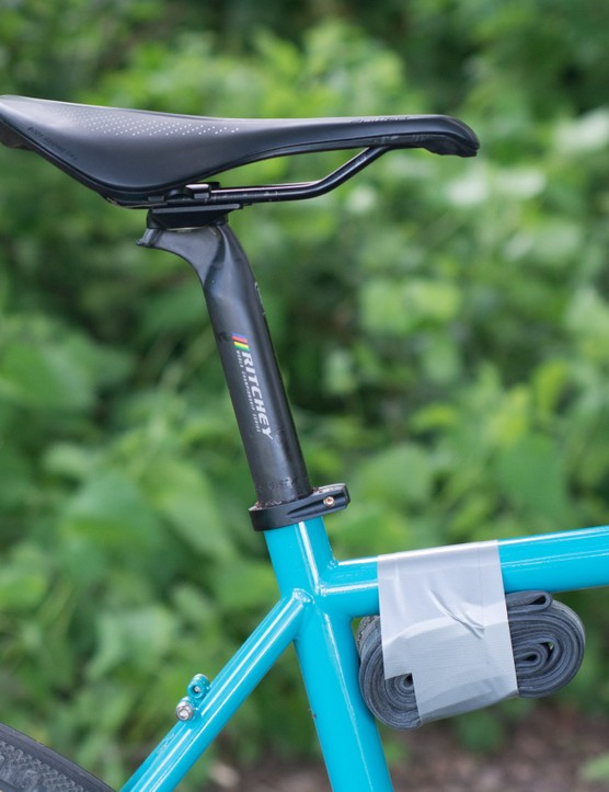 Seatpost, saddle and inner tube taped to frame.