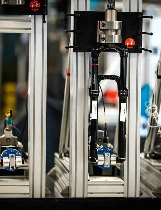 MTB fork testing machine at RockShox HQ in Colorado