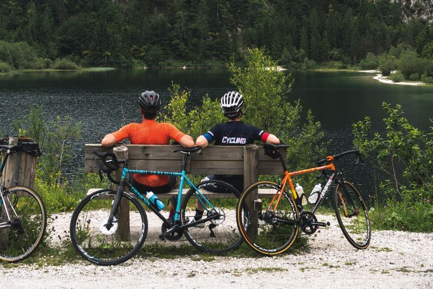 Male cyclists taking a well rest and enjoying the view in Slovenia