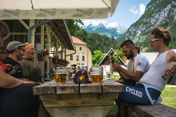 Cyclists take time out for a beer during their ride through the Julian Alps of Slovenia