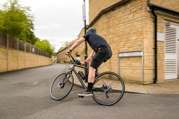 Cyclist in black riding the Cannondale Quick 4 Disc with Cytronex