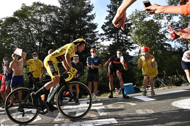 TOPSHOT - Team Jumbo rider Slovenia's Primoz Roglic wearing the overall leader's yellow jersey rides during the 20th stage of the 107th edition of the Tour de France cycling race, a time trial of 36 km between Lure and La Planche des Belles Filles, on September 19, 2020. (Photo by Anne-Christine POUJOULAT / AFP) (Photo by ANNE-CHRISTINE POUJOULAT/AFP via Getty Images)