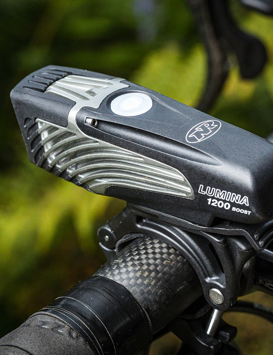 Angled view Niterider Lumina 1200 Boost front light for road cycling