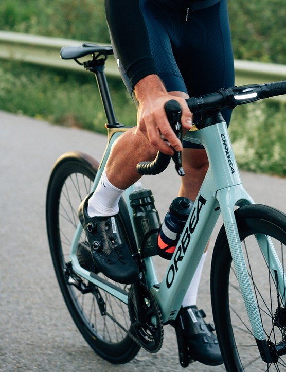 Male cyclist riding the Orbea Gain Carbon road eBike