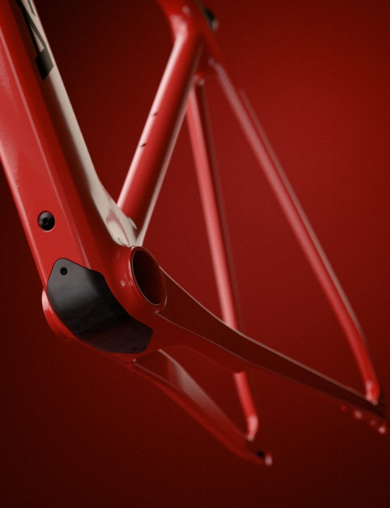 Frame of the Orbea Gain Carbon road eBike in a coral paint scheme