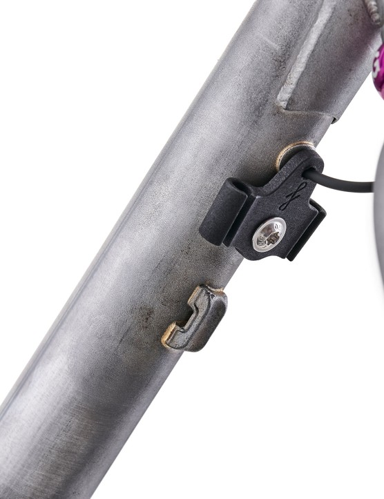Cable guide bolted to underside of downtube