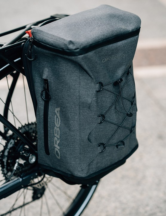 The pannier bag on the Orbea Vibe easily coverts to a back pack for carry off the bike