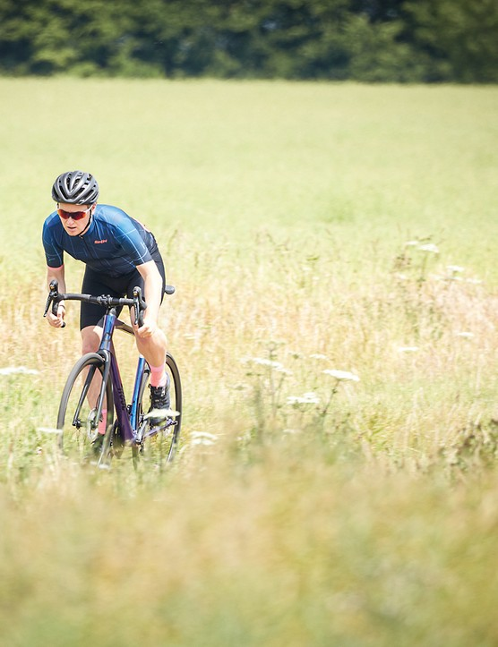 Male cyclist in blue riding the Rose Reveal Four Disc Ultegra bike