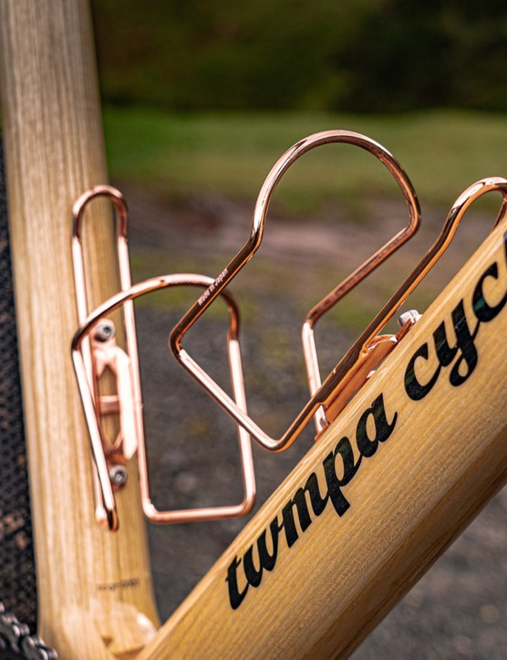 Metal bottle cages mounted to frame