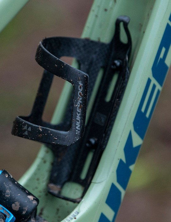 The full range of the Nukeproof Giga full suspension mountain bikes come with custom bottle cage