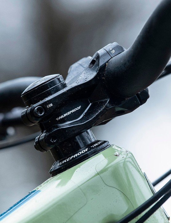 The Nukeproof Giga range of full suspension mountain bikes come with own brand stem, grips and bar