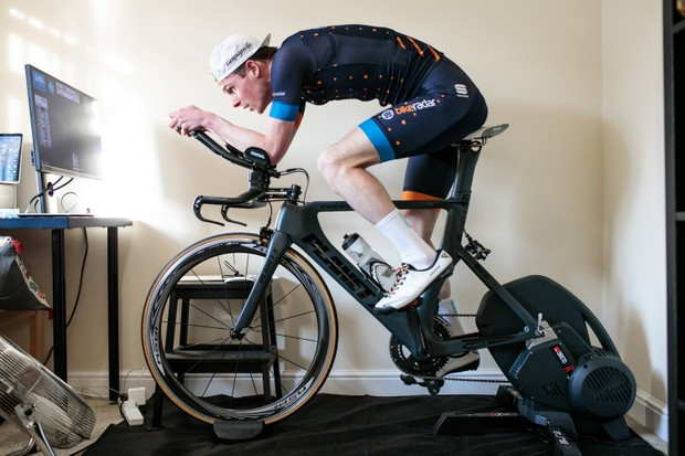 Simon Bromley riding a time trial bike on a smart trainer