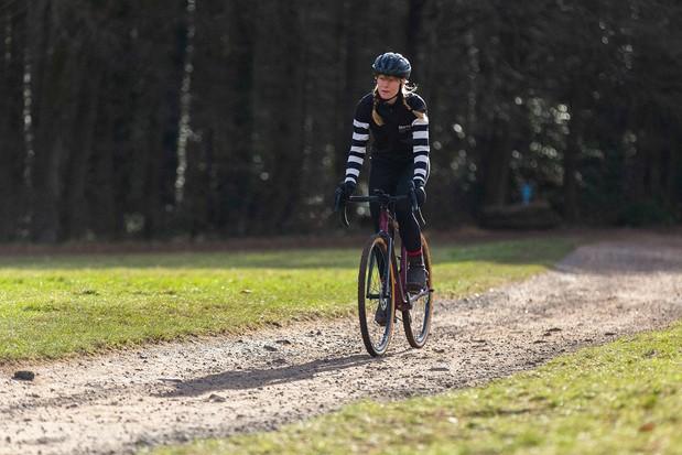 Female cyclist riding the Canyon Grail AL 6 WMN gravel bike