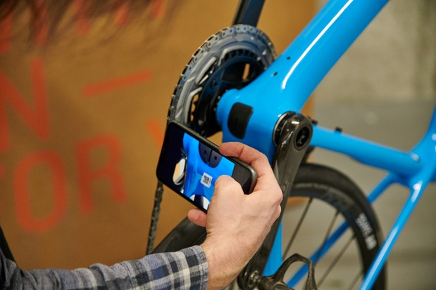 How to assemble a bike, taking a photograph of the frame's serial number