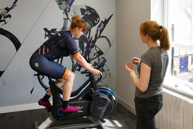 Female cyclist having a professional bike fit