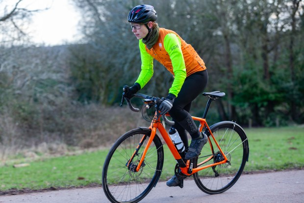 Felix Smith riding the Cannondale Synapse endurance road bike with mudguards and lights