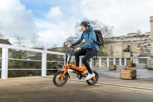 Cyclist in blue top riding the MiRider One folding bike
