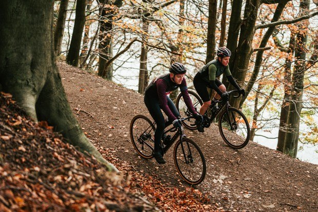 Man and woman riding Ribble electric gravel bikes