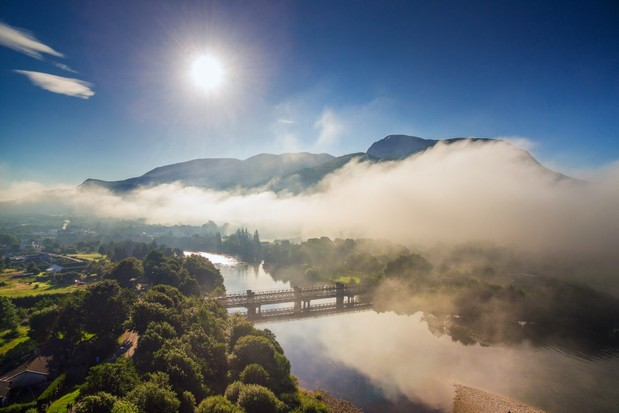 The River Lochy with Ben Nevis above the mist in the distance