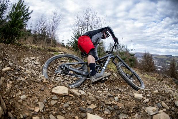 Cyclist in red shorts riding the Trek Slash 8 full suspension mountain bike