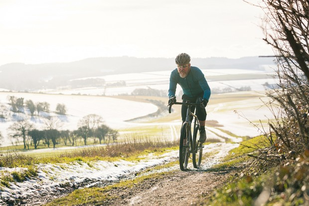 Male cyclist in blue top riding the Vitus Substance SRS 1 gravel bike