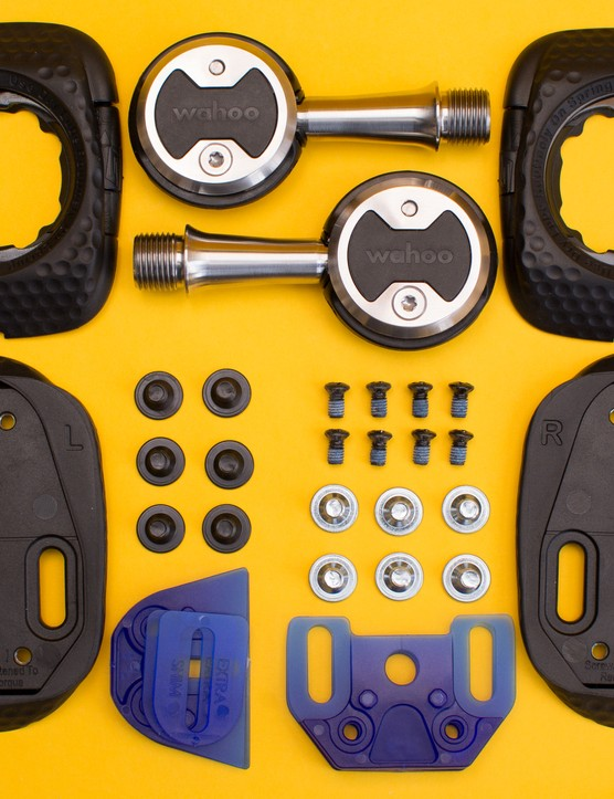 Contents of Wahoo Speedplay Zero box including pedals, cleats, adapters and mounting hardware